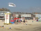[The Olympic flag flying on Weymouth beach]