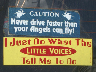 [Two car stickers: 'Never drive faster than your angels can fly' and 'I just do what the little voices tell me to']